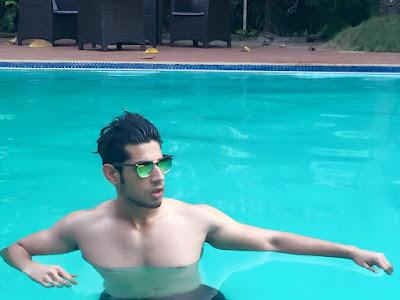 zain in pool