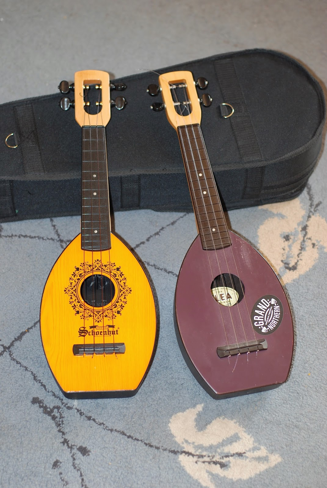 Schoenhut Oak Mahogany Ukulele next to Flea