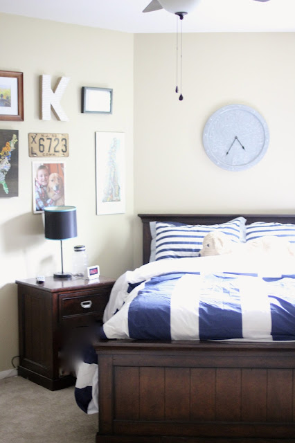 Boys Room with gallery wall and striped duvet cover comforter via www.goldenboysandme.com