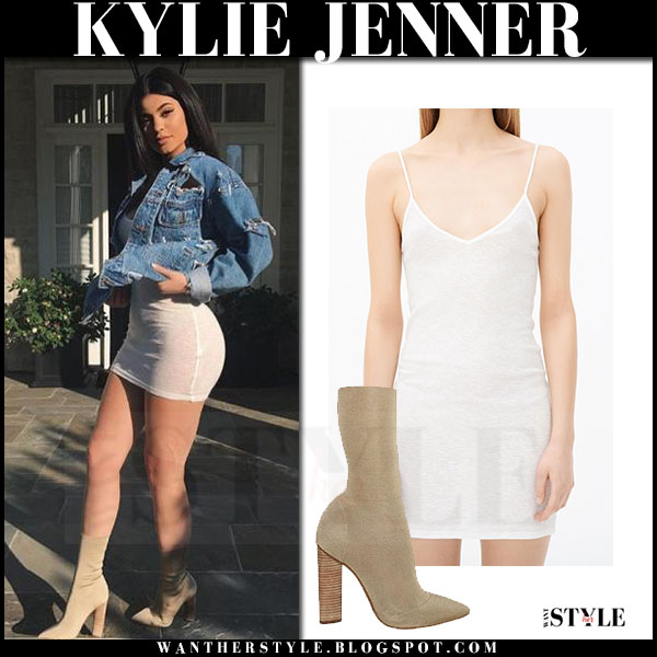 Kylie Jenner in denim jacket, white mini dress and beige yeezy season 2 boots what she wore
