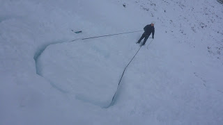 Constructing Snow anchors and snow bollards  on University club winter skills and winter mountaineering at Cairngorm