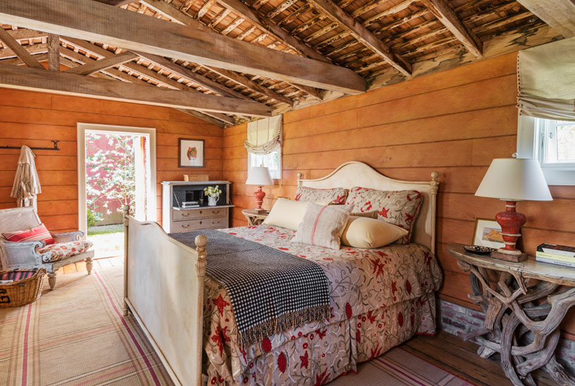 Rustic shiplap walls in beautiful bedroom of Barn conversion home by Carrier and Company