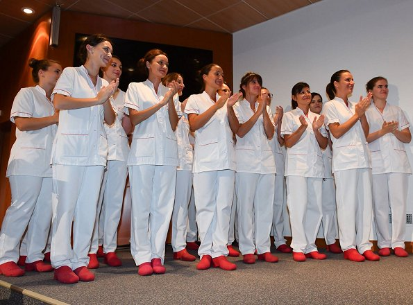 Princess Caroline of Hanover attended graduation ceremony of Nursing Training Institute in Monaco. white satin blouse