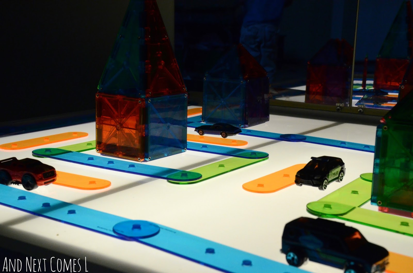 Translucent city and cars on the light table from And Next Comes L