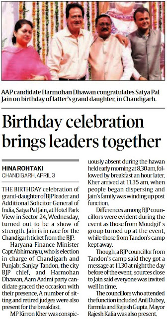 Aap candidate Harmohan Dhawan congratulates Satya Pal Jain on birthday of latter's grand daughter, in Chandigarh.