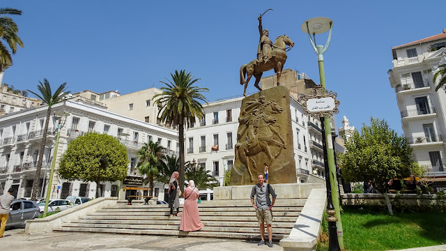 Nice statue at the walking street with coffee shops in Algiers
