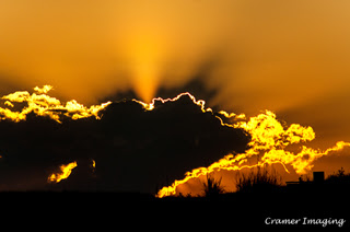 Cramer Imaging's professional landscape photograph of a dramatic orange sunset with clouds in silhouette in Tetonia, Teton, Idaho