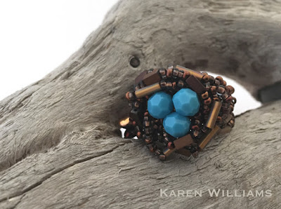 Robin's Nest ring with three crystal 'eggs' by artist Karen Williams