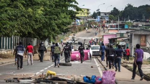 Police and protesters in Libreville