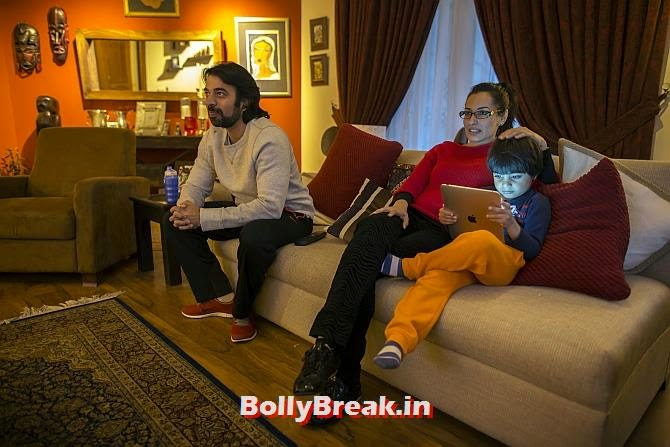 Naadiya Manzur, director of Treehouse Nursery and Kindergarten school, watches television with her husband Omar and son Zidaan at her house in Islamabad., You will love these Pakistani Bold Women of 2014