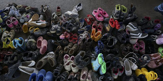 Migrant children's shoes dumped in Hungary. (Image Credit: Mstyslav Chernov) Click to Enlarge.