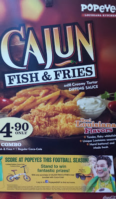 A poster for Popeyes (right side of poster cropped) for its Cajun fish and fries also refers to the 'football season'.