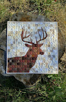 Reverse applique deer mini quilt
