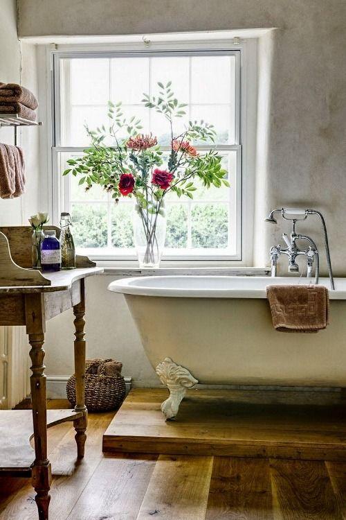 Clawfoot tub and wide plank wood flooring in #Frenchfarmhouse bathroom