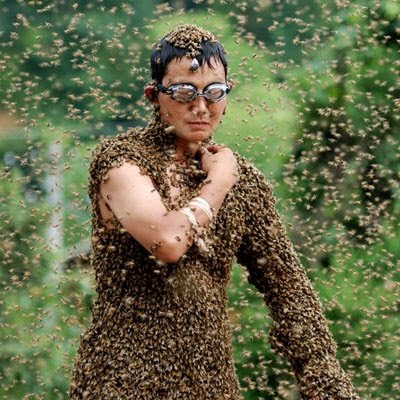 Bees covering a man