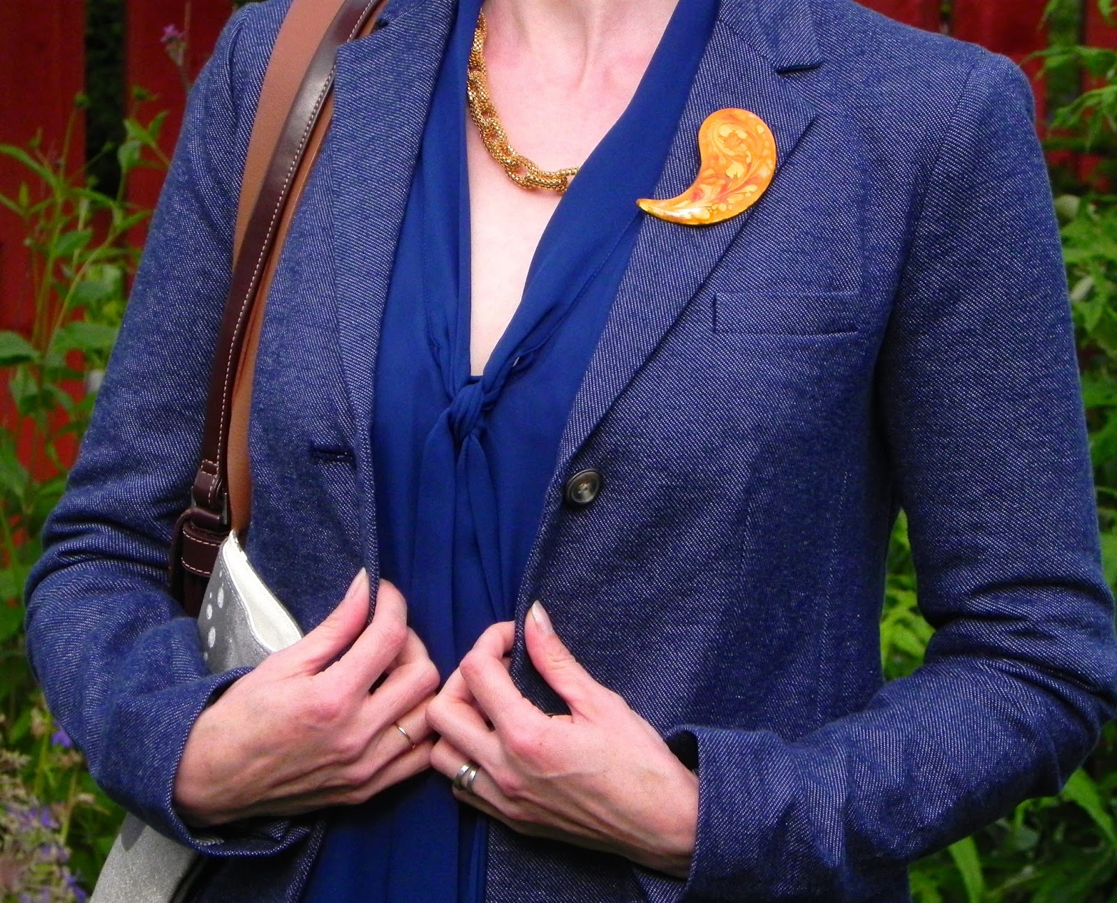 Blue jacket, vintage brooch.