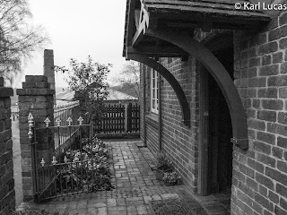 The front door of the Doctors house black+white Blists Hill
