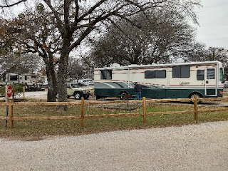 Motorhome and Jeep in an RV park campsite