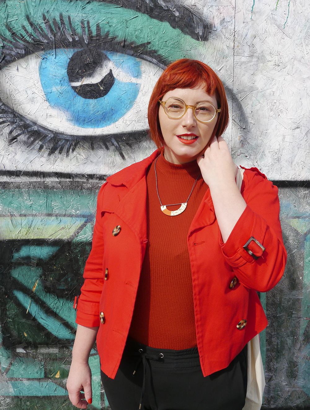 Scottish blogger Helen from Wardrobe Conversations wearing CrossEyes glasses with red and orange outfit