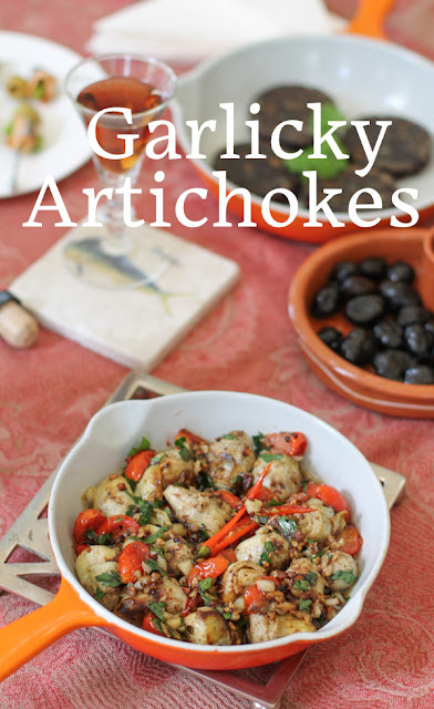 Food Lust People Love: Alcachofas al Ajillo or garlicky artichokes are a traditional tapas dish from Spain made with fresh or canned artichokes, lots of garlic and chili pepper. I like to toss in some small tomatoes as well, for flavor and color.