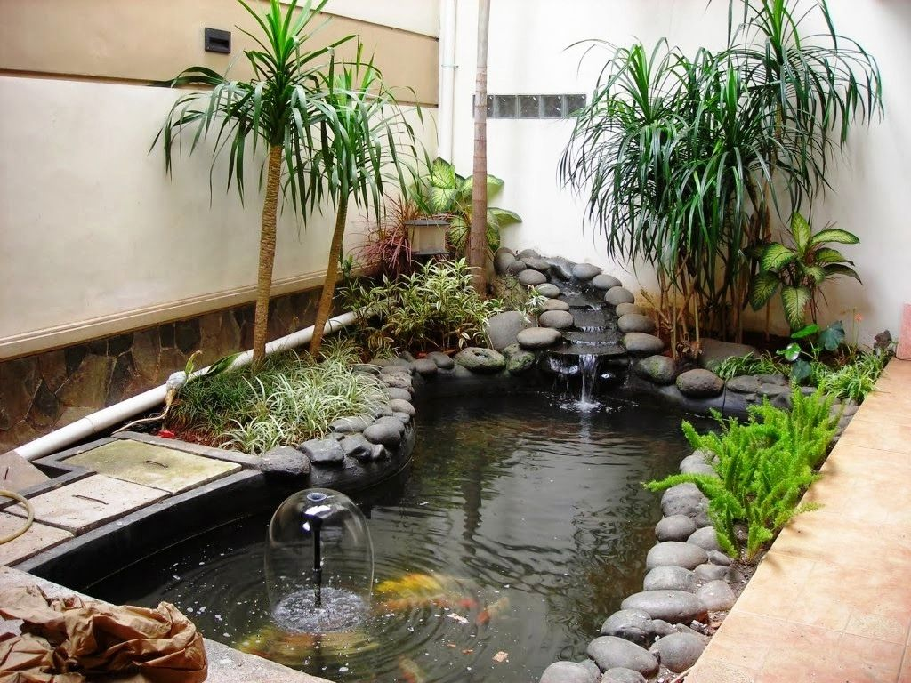 Desain Taman Minimalis Dengan Kolam Ikan Modern