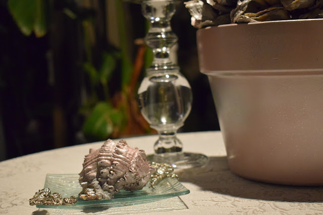 Shells; glass candle holder ; Patio, table cloth & linen