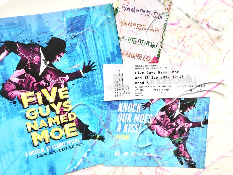 Flat lay image of the show programme, tickets and confetti