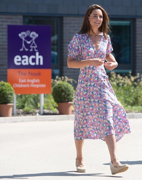 Kate Middleton wore a new pastel floral pattern dress by Faithfull the Brand, Russell and Bromley wedges, Accessorize hoop earrings