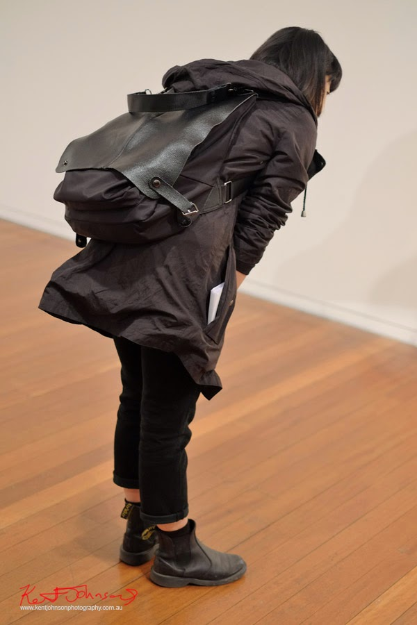 Black coat, pants and Black leather backpack/satchel - Street Fashion Sydney by Kent Johnson.
