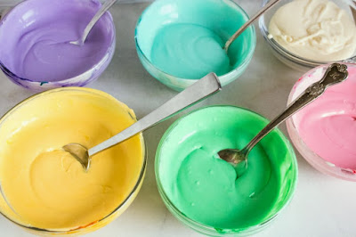 small bowls of various colors of ice cream base