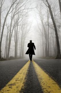 Man Walking Down The Road