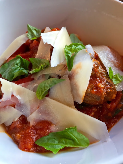 San Marzano tomato sauce with meatballs, parmesan and basil