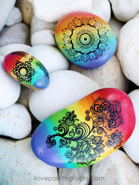 how to paint rocks with rainbow ombre effect and henna inspired mandalas and tattoos on painted rocks