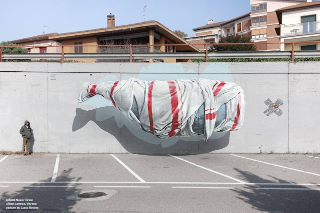 The streets of Varese in Italy and the Urban Canvas Street Art Festival just welcomed the good lads from NEVERCREW which created yet another fantastic piece of work featuring one of their signature whales.