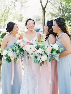 bride and bridesmaids in dusty blue dresses