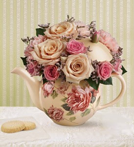 vintage teapot with pink roses