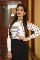 Manjusha in sleevelss crop top and black skirt at Darshakudu pre release ~  Exclusive Celebrities Galleries 098.JPG