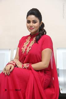 Actress Poorna Latest Stills in Red Dress at Rakshasi First Look Launch  0240.JPG