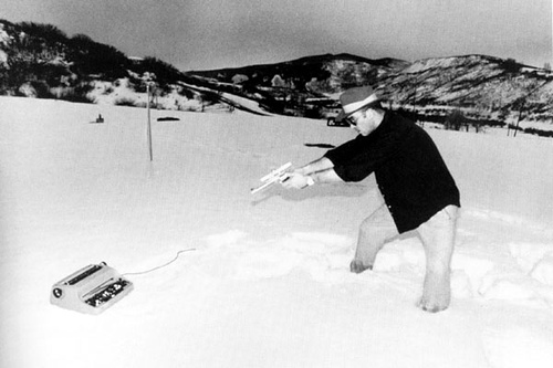 Hunter S. Thompson shooting his typewriter
