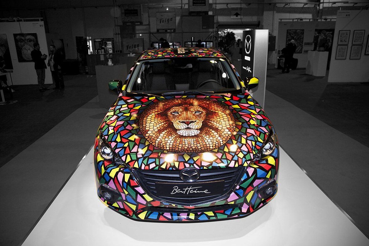 Ben Heine Art on Mazda Car at Brussels Affordable Art Fair (lion made of circles and colorful abstract composition) - 2015