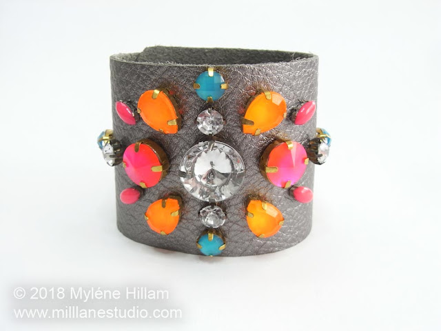 Pewter coloured leather cuff featuring neon bright and crystal rhinestones