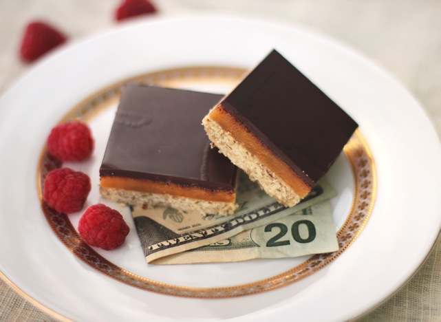 These delicious Healthy Millionaire's Shortbread Bars have a gluten free shortbread base, refined sugar free caramel filling, and dark chocolate topping! You'll feel like royalty with every bite!