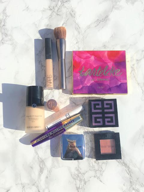 Makeup bag essentials Giorgio Armani, Nars, Givenchy, Loreal, Hourglass, Dior, Tarte