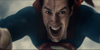 Superman smiles while flying.