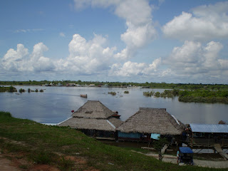 Huts over the water in the Amazon