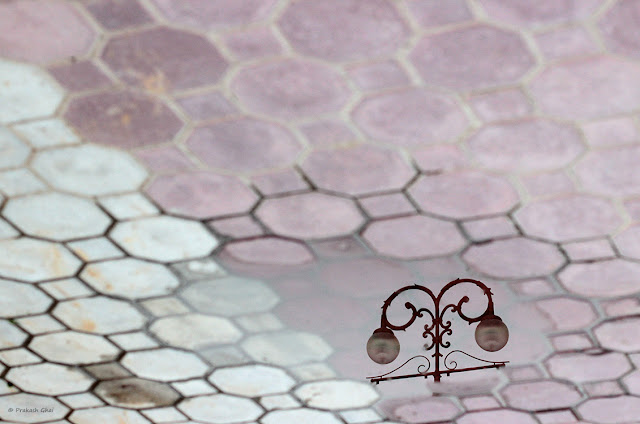A Minimalist Photograph of the reflection of Garden Lamps at the Akshardham Temple, Jaipur