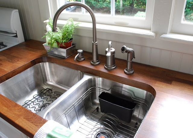 butcher block countertops and stainless sink.