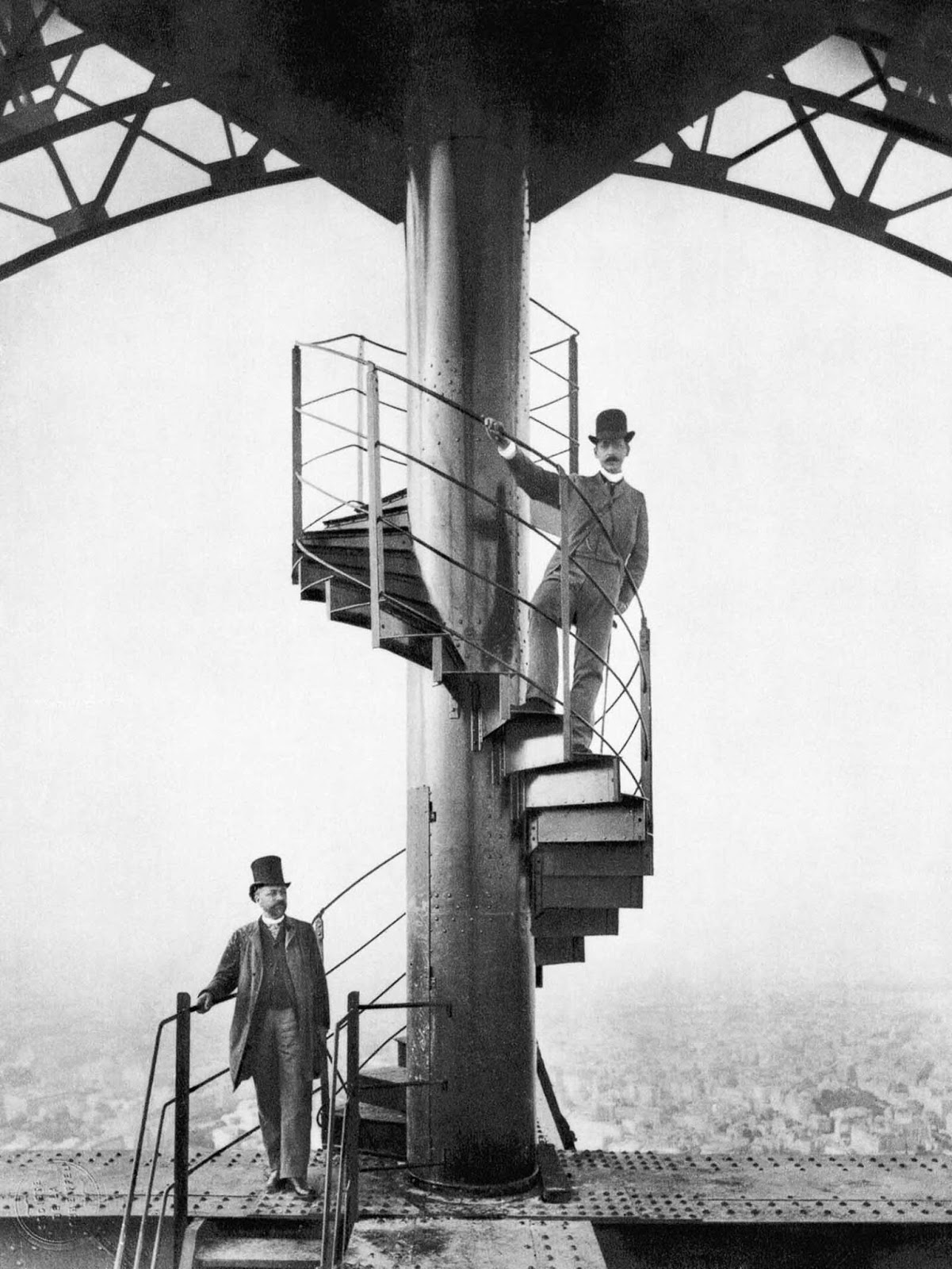 Alexandre Gustave Eiffel, left, explores the completed tower with a friend.