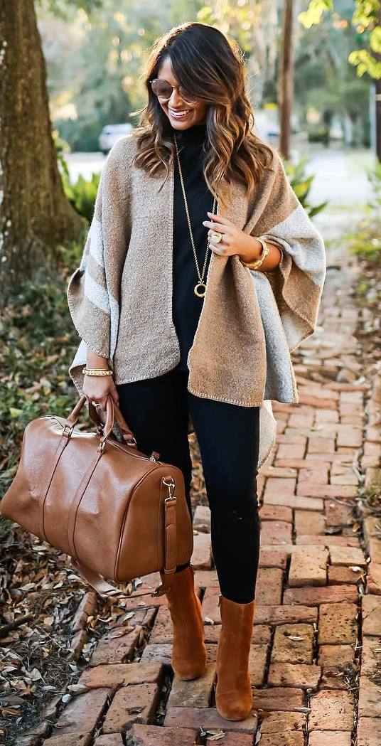 trendy outfit idea: poncho + top + bag + boots + skinny pants