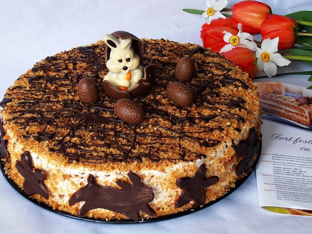 http://www.caietulcuretete.com/2013/04/tort-festiv-cu-nuci-si-crema-de-whisky.html